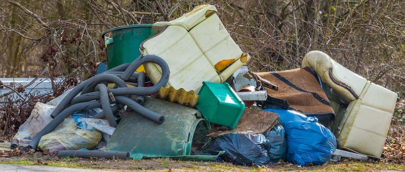 Garbage Dump Outside Needing a Dumpster