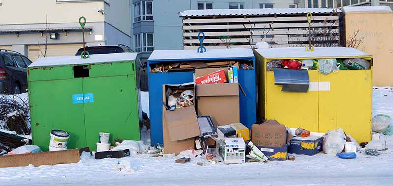 Image of a Group of Filled Dumpsters Following New Years Eve